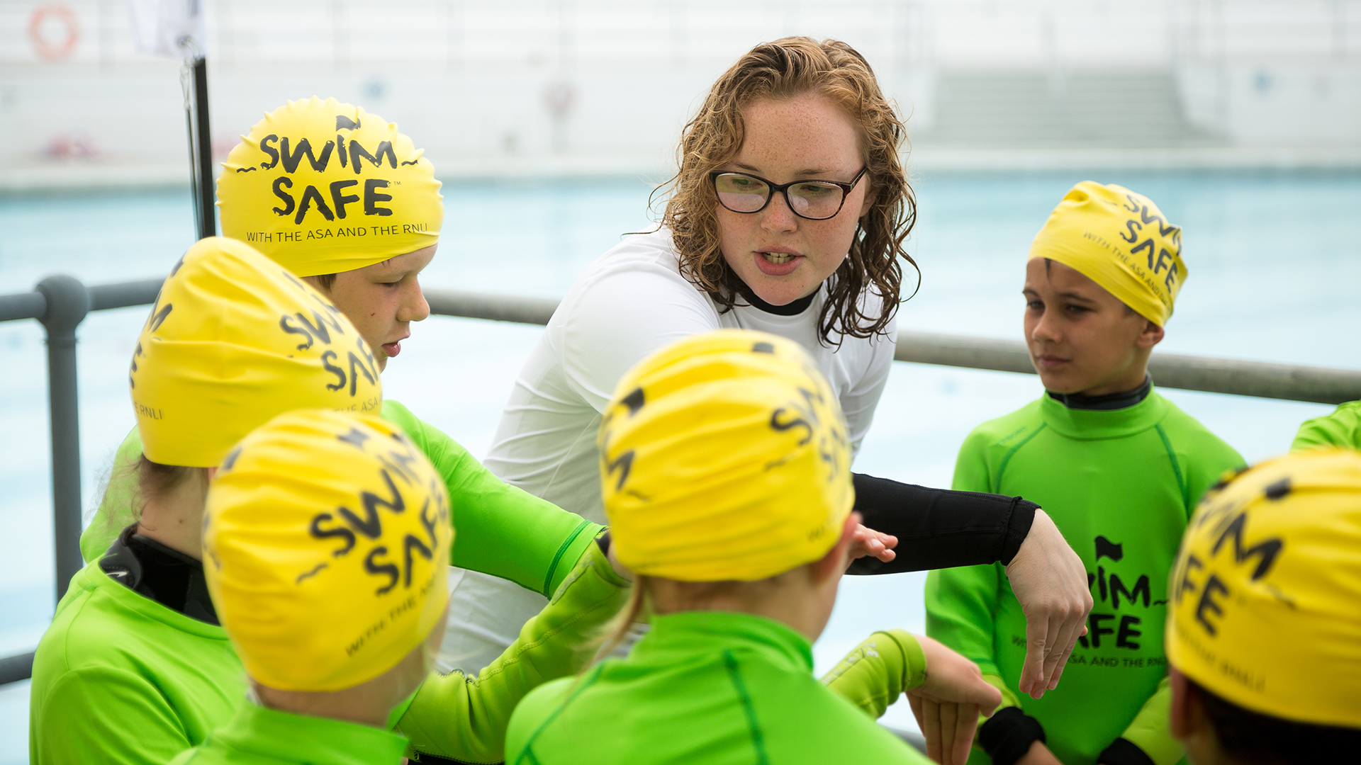 A Swim Safe instructor teaching children at Plymouth's Tinside Lido in Devon